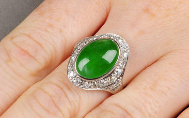 A natural jadeite cabochon and circular-cut diamond cluster ring.