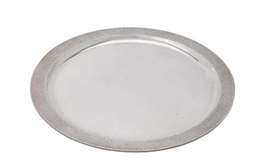 A silver circular salver by Christopher Lawrence