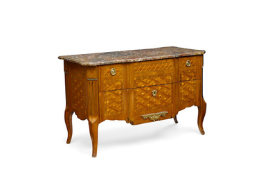 A Louis XV/XVI Transitional Style Gilt Metal Mounted and Parquetry Inlaid Kingwood Commode