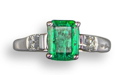 An emerald and diamond ring, the emerald-cut emerald...