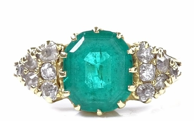 An early 20th century unmarked gold solitaire emerald ring, ...