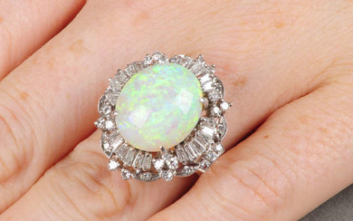 An oval opal cabochon and vari-cut diamond cluster ring.