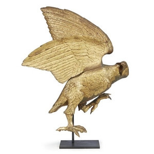 Carved and gilded figure of an eagle in flight...