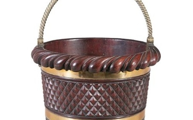 A MAHOGANY AND BRASS BOUND BUCKET, c.1830, with ro…