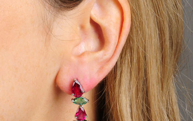 A pair of pink tourmaline and emerald asymmetric drop earrings.