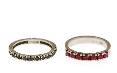 A sapphire and a ruby eternity ring respectively set with numerous circular-cut sapphires and rubies. Size 52. (2)