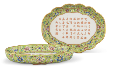 A PAIR OF FAMILLE ROSE LIME-GREEN-GROUND FOLIATE-RIMMED OVAL TRAYS, JIAQING SIX-CHARACTER MARKS IN IRON-RED AND OF THE PERIOD (1796-1820)