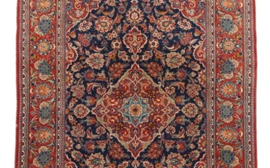 Keshan rug, classic medallion design with ornaments, flowers and foliage on blue base. Persia. 20th century. 213×130 cm.