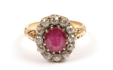A Red Stone and Diamond Cluster Ring, the oval cut...
