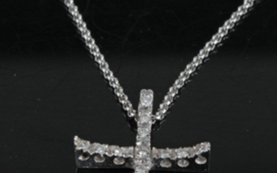 Cross pendant in 18kt gold with diamonds 0.20ct