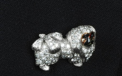 An 18ct gold diamond Pekingese dog brooch, with