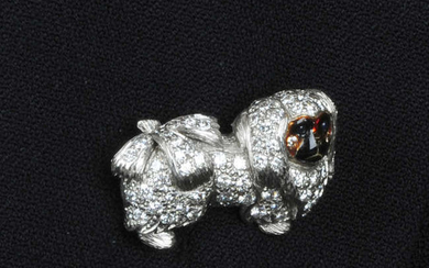 An 18ct gold diamond, sapphire and enamel Pekingese dog brooch.