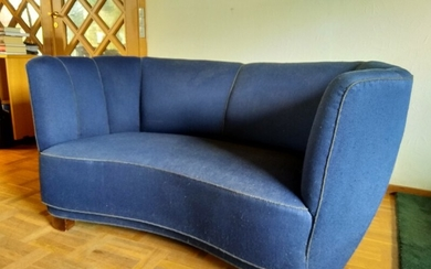 Danish furniture design: A slightly curved two-seater sofa, upholstered with blue fabric. L. 145. D. 90 cm.