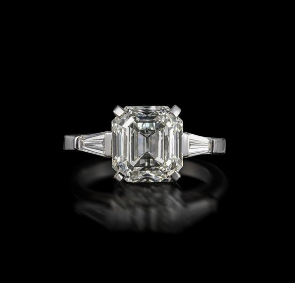 A diamond solitaire ring, the Asscher-cut diamond weighs...