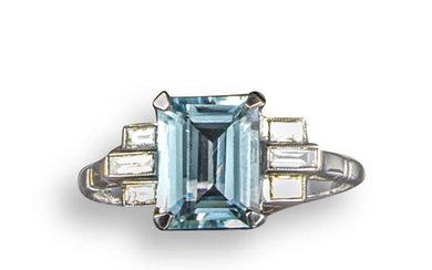 An aquamarine and diamond ring, the emerald-cut aquamarine...