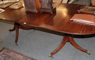 A 20th century mahogany twin pedestal D end dining table,...