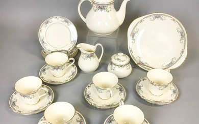 "Royal Doulton ""Juliet"" Tea Set, England, 1981, teapot, covered sugar, creamer, six teacups and saucers, cake six plates, and a small pl"