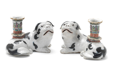 A pair of Chinese Export porcelain 'pug dog' candle holders