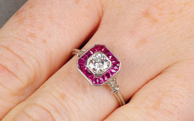 A brilliant-cut diamond and calibre-cut ruby cluster ring.