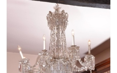 A cut glass eight light chandelier in late George III style