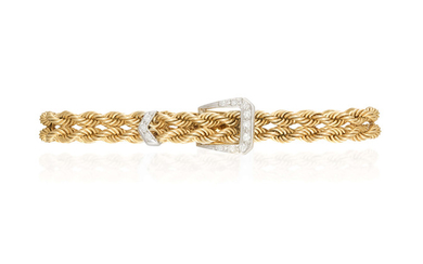 A GOLD AND DIAMOND BRACELET...