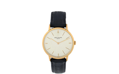Patek Philippe. An 18K gold manual wind wristwatch