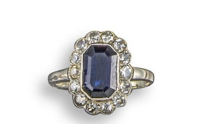 A sapphire and diamond cluster ring, the emerald-cut...