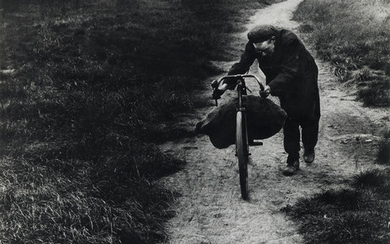 BILL BRANDT (1904-1983) Coal-Searcher Going Home to...