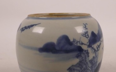 A Chinese blue and white porcelain pot decorated with a rive...