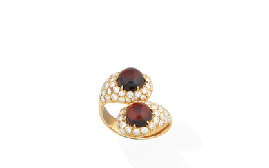 A garnet and diamond crossover ring