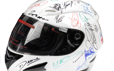 A helmet signed by many racing drivers and motorsport personalities, obtained at the Goodwood Festival of Speed 2015,