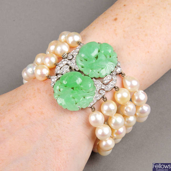 A natural jadeite and diamond clasp, on cultured pearl bracelet.