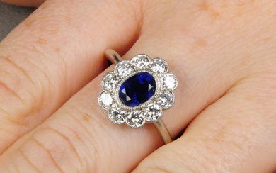 An unheated sapphire and diamond floral cluster ring.