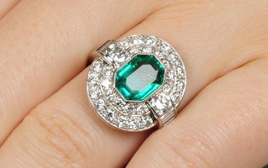 A Colombian emerald and diamond cluster ring.With