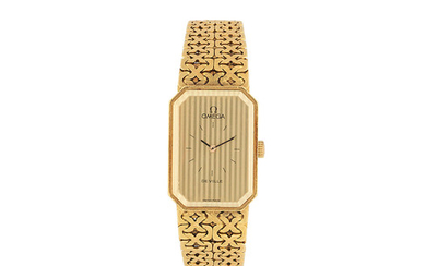 Omega. A lady's 18K gold manual wind bracelet watch