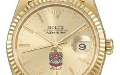 ROLEX. A VERY RARE 18K GOLD AUTOMATIC WRISTWATCH WITH SWEEP CENTRE SECONDS, DAY, DATE, CHAMPAGNE DIAL WITH THE UAE DESERT EAGLE COAT OF ARMS AND BRACELET, MADE FOR HIS HIGHNESS SHEIKH MOHAMMED BIN RASHID AL MAKTOUM, SIGNED ROLEX, OYSTER PERPETUAL,...
