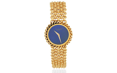 Patek Philippe. A lady's 18K gold manual wind bracelet watch with lapis lazuli dial