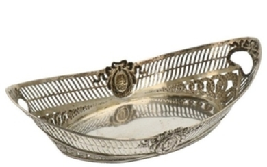 Puffs basket model with molded flower and medallion decorations and open sawn silver bars.