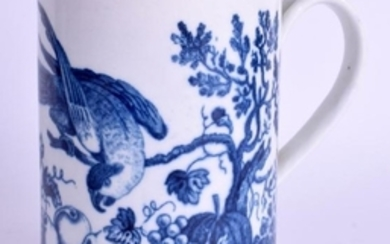 AN 18TH CENTURY WORCESTER MUG decorated with the parrot