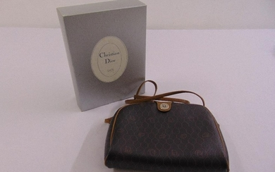 A Christian Dior leather bag with strap handle in original p...
