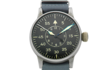 A. Lange & Sohne. An oversized German military steel manual wind observation wristwatch accompanied by a pilots compass