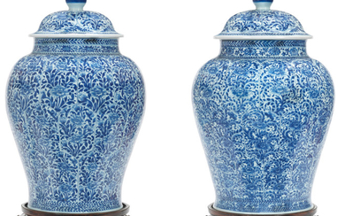 A large Pair of blue and white jars and covers